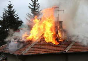 Burning house roof will require the Idaho Falls Sunrise Cleaning and Restoration